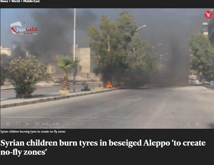 الأطفال السوريين يحرقون الإطارات في حلب المحاصرة لإنشاء مناطق حظر الطيران