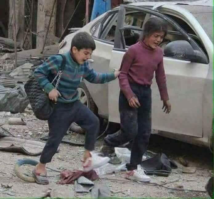 طفل-وطفلة-بعد-قصف-مدينة-حلب-سوريا